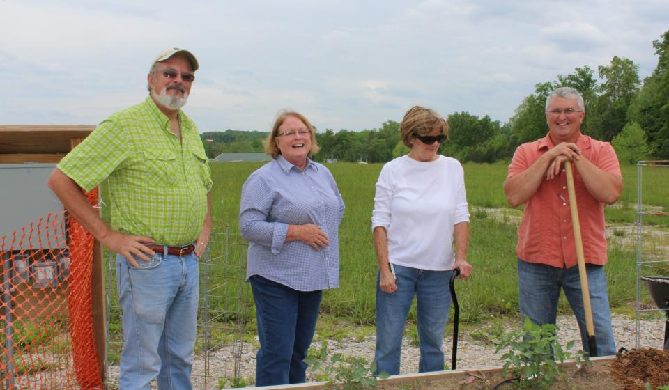 The ladies learn how to layout their raised bed gardens.